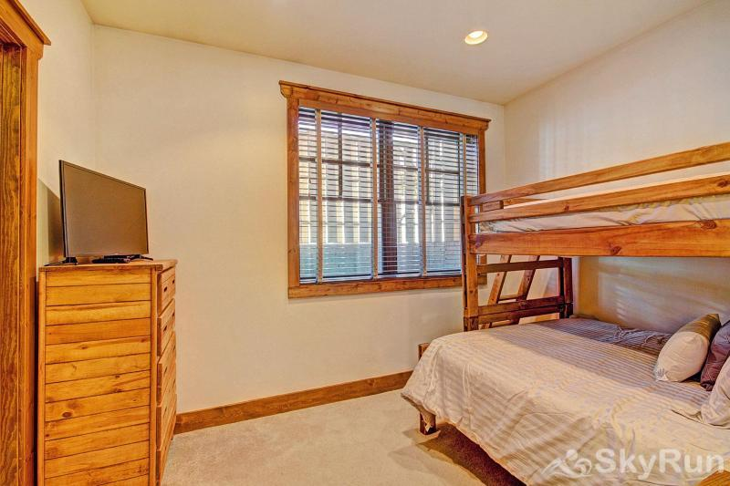 Mountain Ridge Chalet Lower level bedroom with queen and twin bunk bed