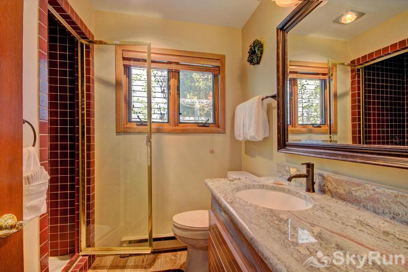 Chimney Ridge 512 Full bathroom on the main level with living room and kitchen