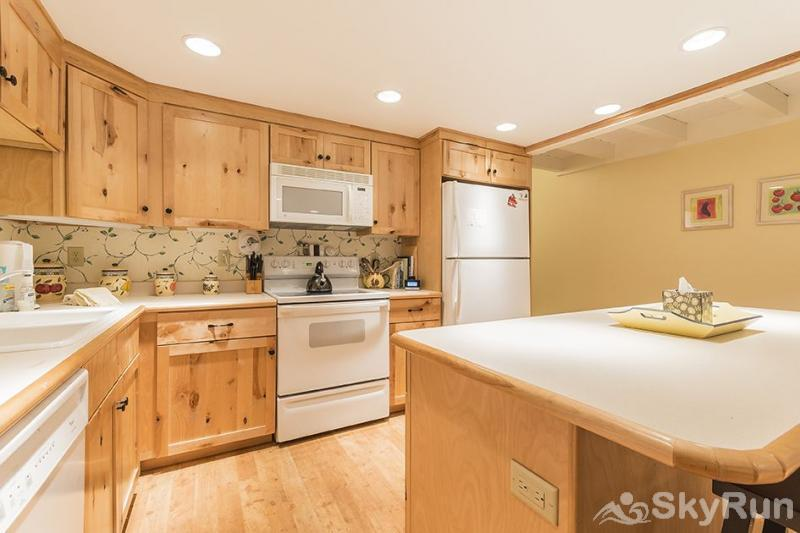 Herbage Townhomes A6 The kitchen is fully-stocked.