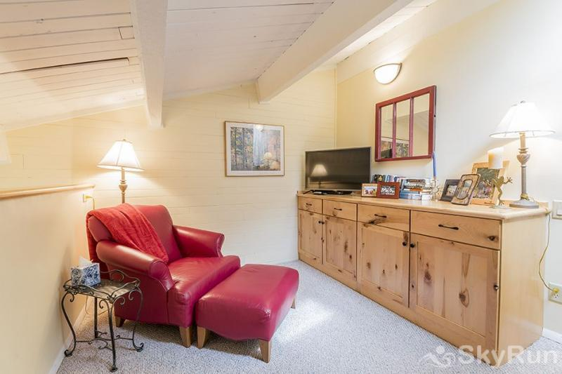 Herbage Townhomes A6 There's a sitting room with a TV for when you want to get away from it all.