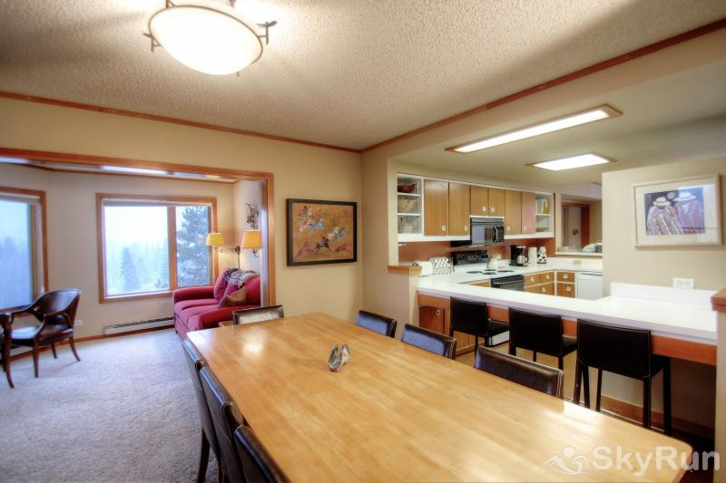 2112 The Pines Dining Table and Kitchen