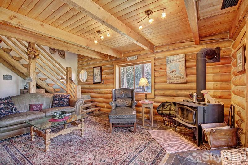Burgett Cabin Inviting living room with wood stove