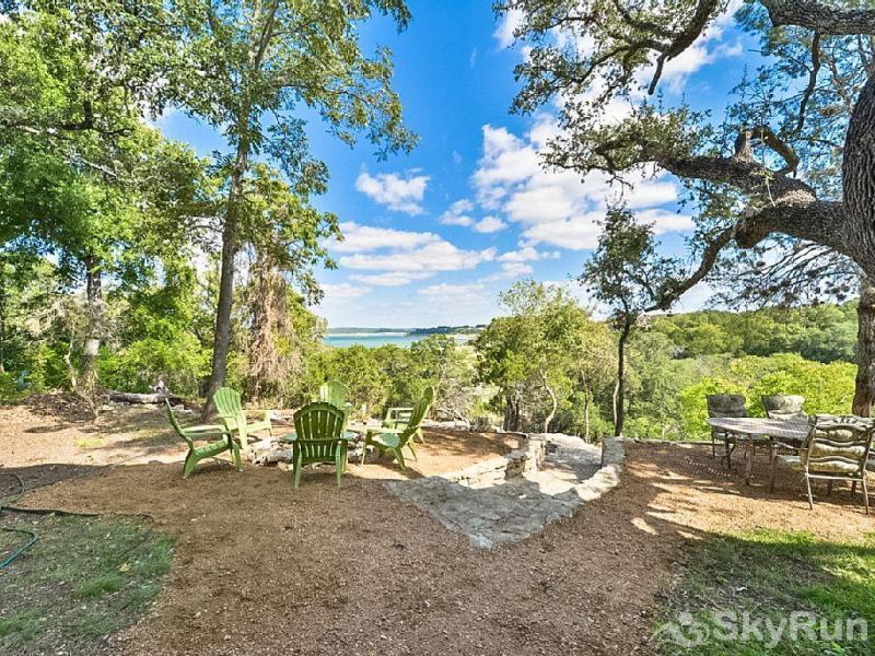 TEXAS ROSE RETREAT Backyard with Campfire Area