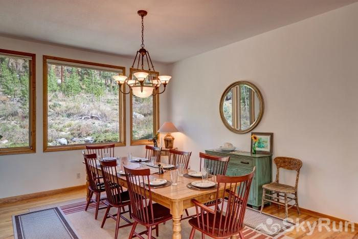 Ten Mile Lodge Dining room table with seating for 8