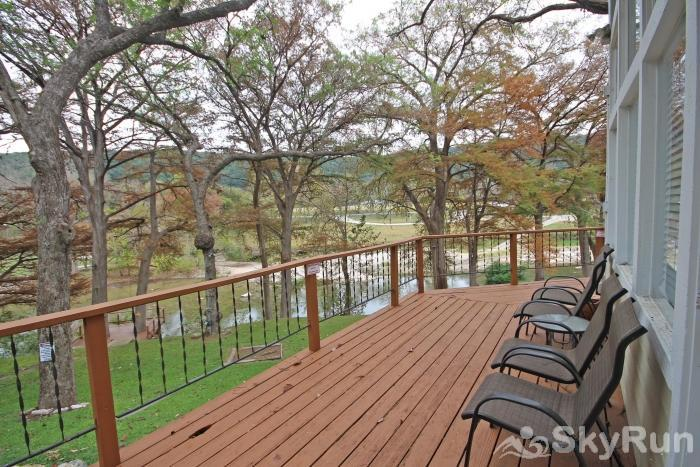 STAR OF TEXAS AND COTTAGE COMBO Wrap Around Deck on Cottage with River View