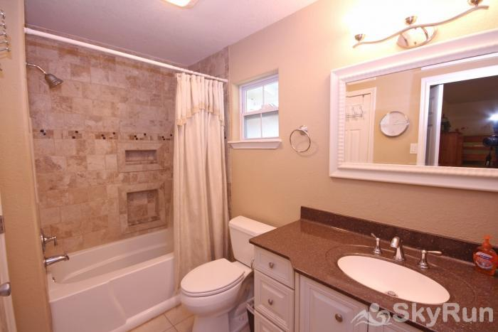 STAR OF TEXAS AND COTTAGE COMBO First Full Bathroom with Shower/Tub Combo