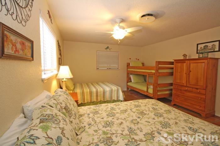 STAR OF TEXAS AND COTTAGE COMBO First Bedroom with Queen, Full, and Twin Bunk Beds
