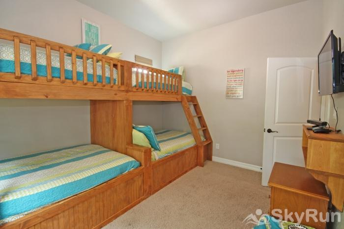 THREE'S A CHARM Third Bedroom with Twin Bunks