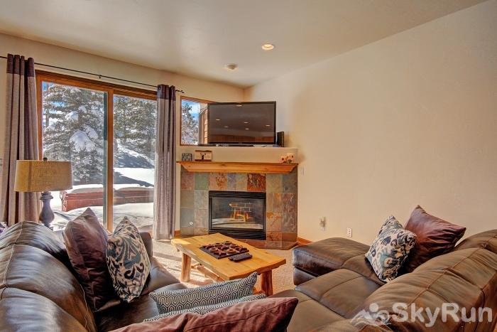 Highland Greens Pine Cozy living room with flat screen TV and gas fireplace