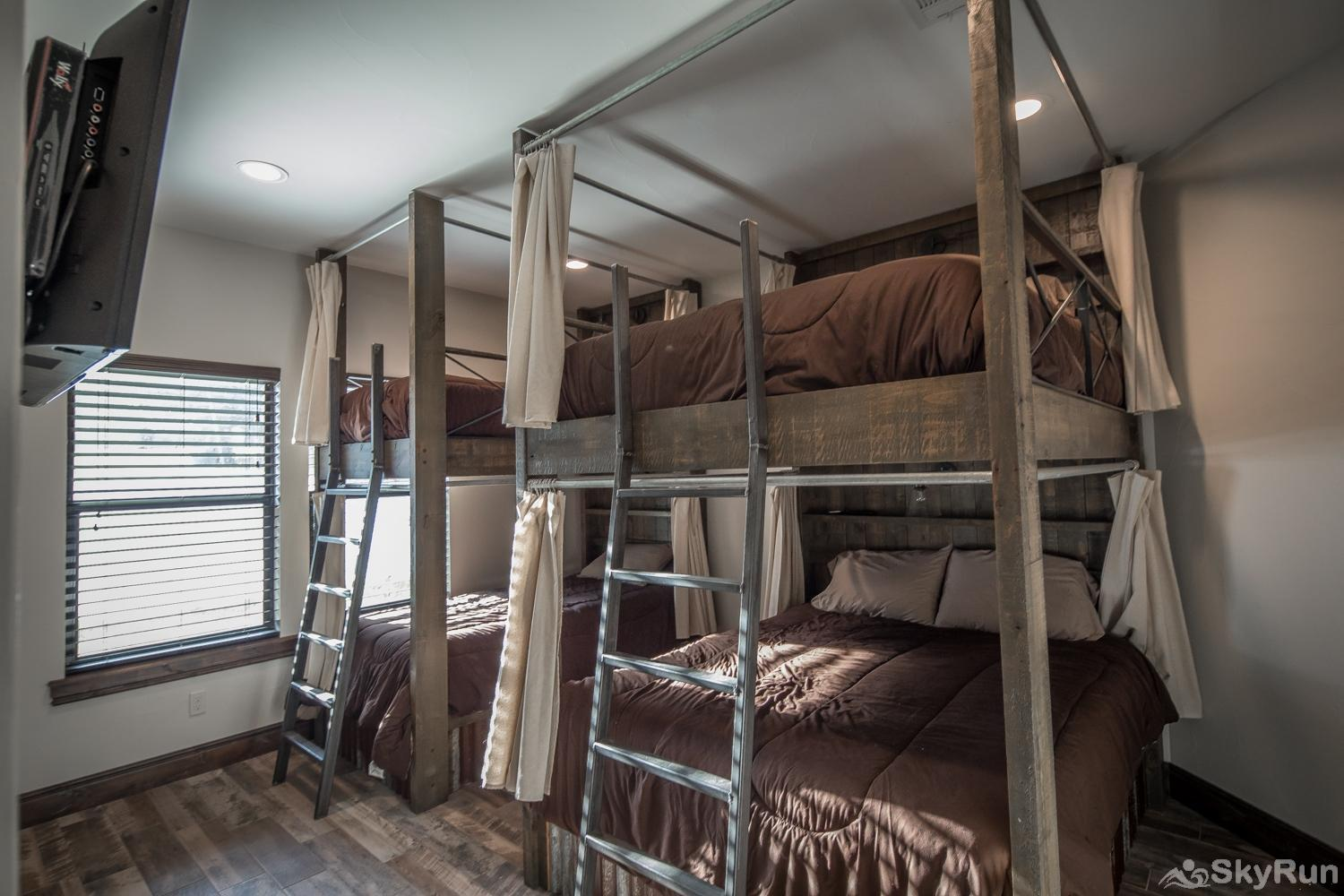 MAGNOLIA HAUS Second Downstairs Bedroom with Queen and Twin Bunks