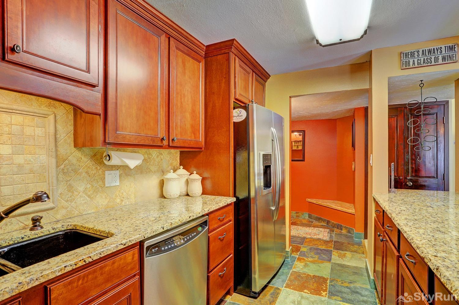 Powderhorn C202 Alternate view of kitchen with full size fridge and dishwasher