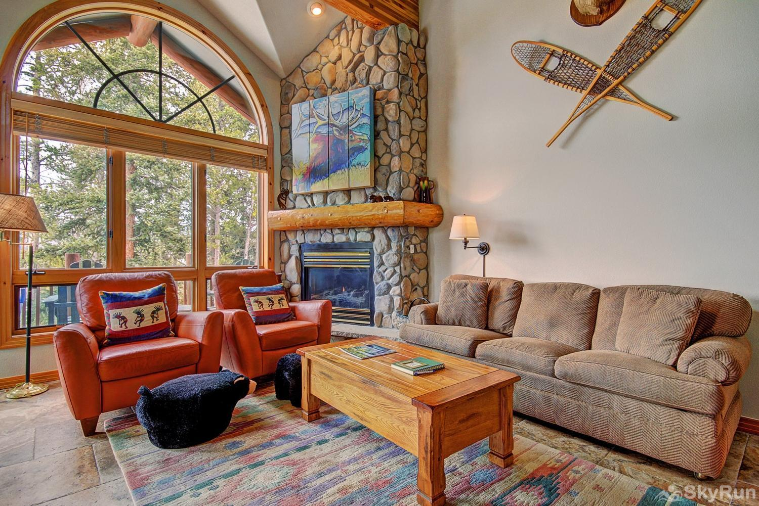 Elk Ridge 406 Luxurious and cozy living area with gas fireplace and gorgeous windows