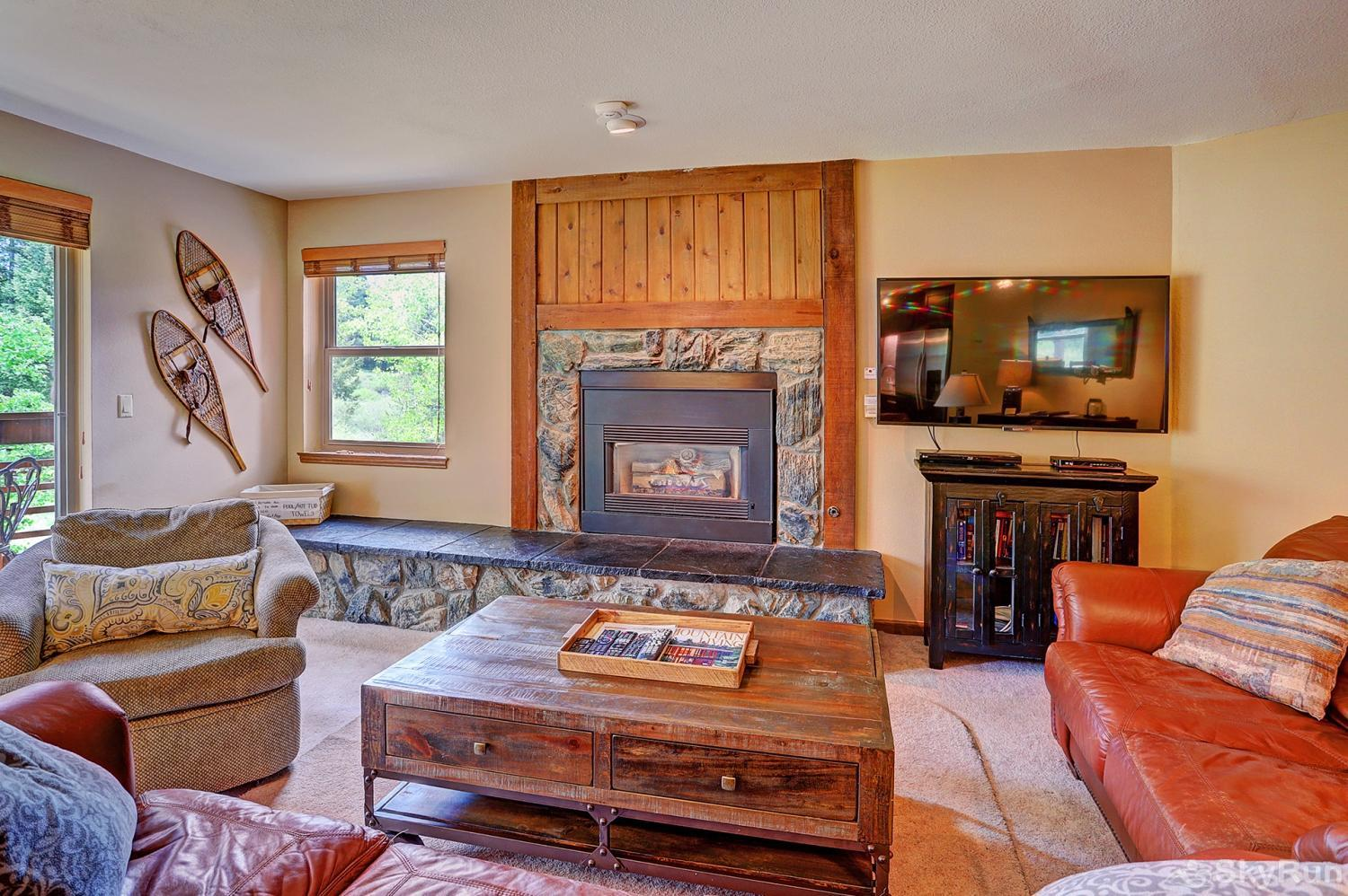 Tyra Summit A2A Cozy up around the gas fireplace with friends and family