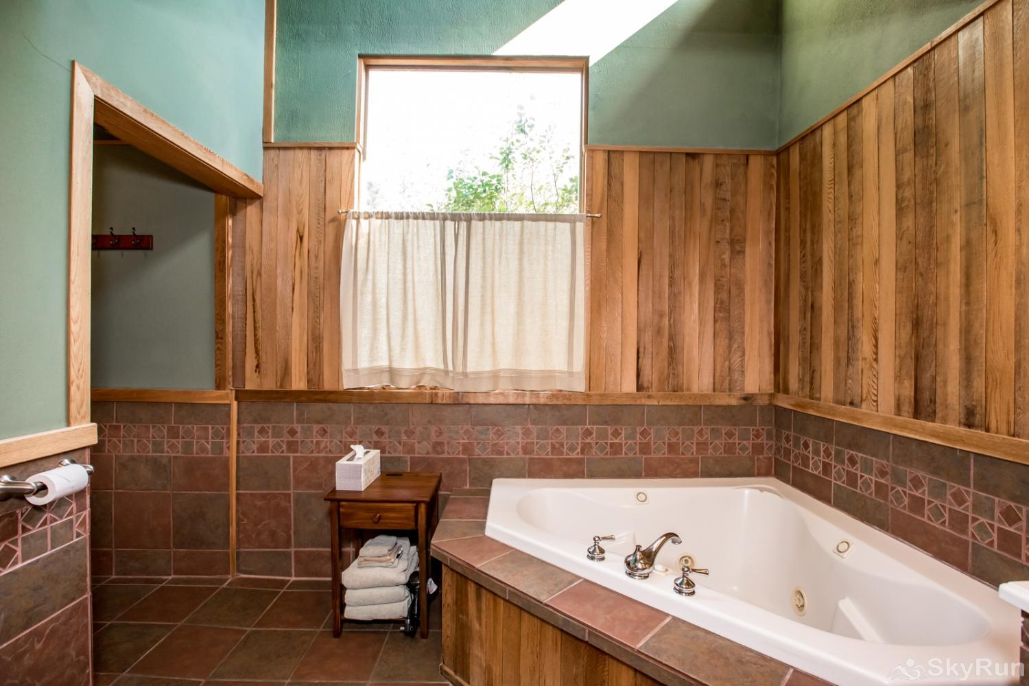 Stillwater Mountain Lodge Master bathroom with tub and double shower in Great House