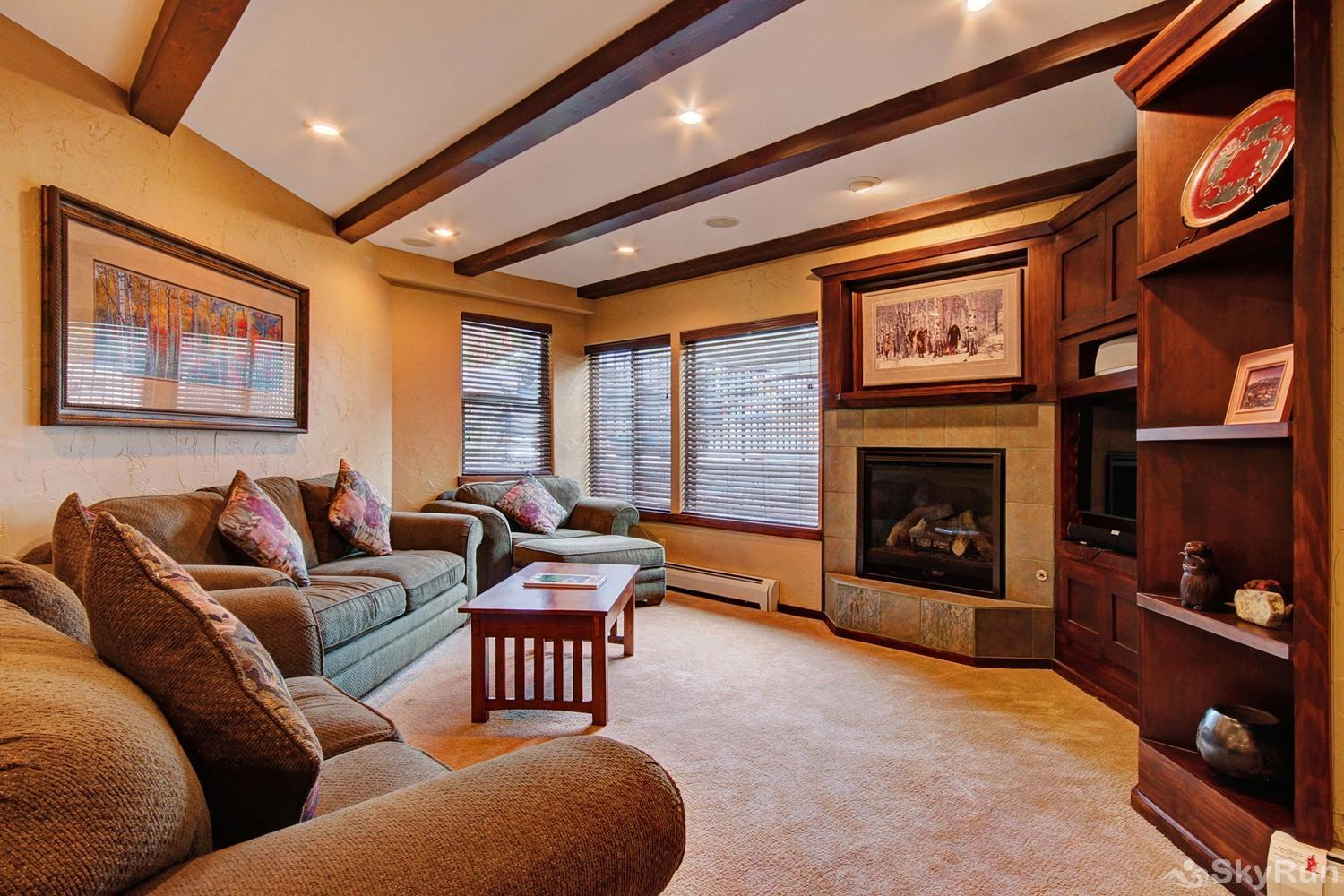 The Lift C12 Cozy living room with gas fireplace and flat screen TV