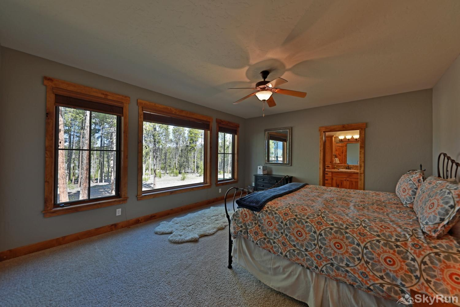 Juniper House Master Bedroom with Ensuite with King  surrounded by view of woods