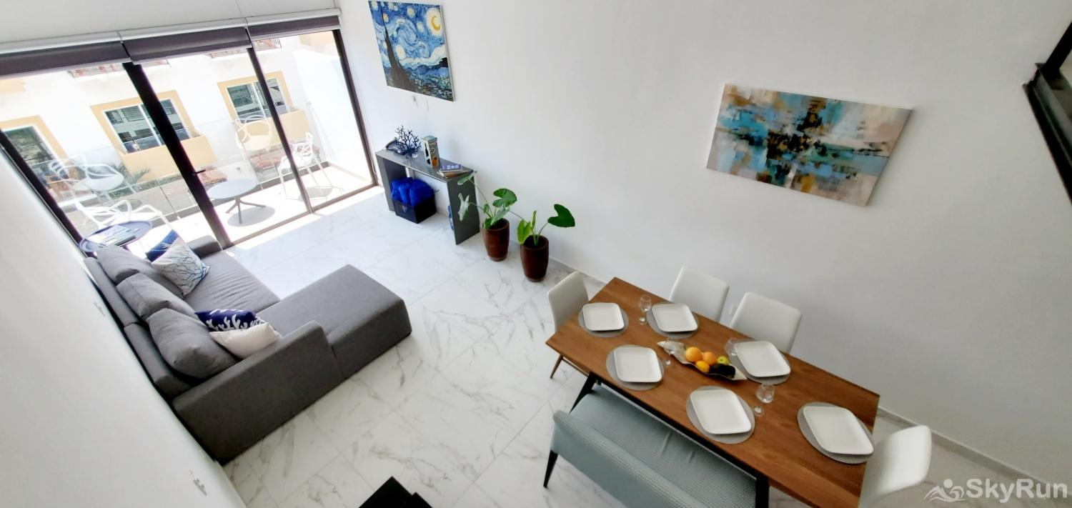 Stylish Beach Condo Steps from Beach 2BR Outdoor Pool, 303 Living and dinning room Moon Loft by SKYRUN