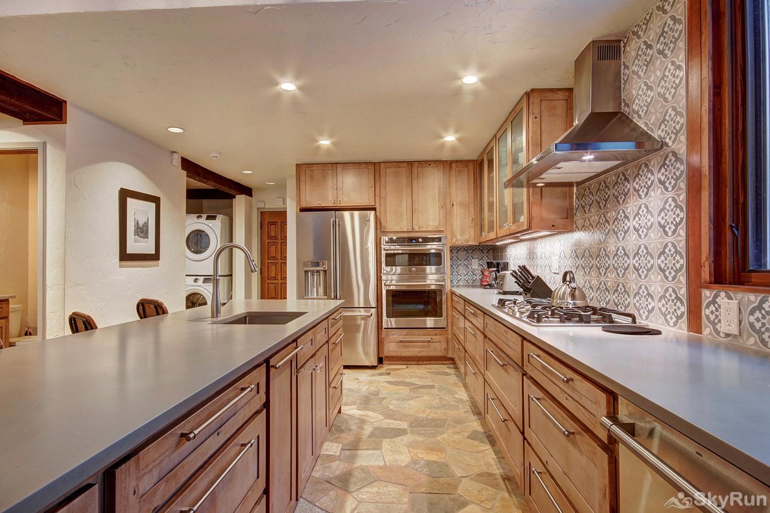 Creekside Chateau Fully equipped kitchen with modern stainless steel appliances
