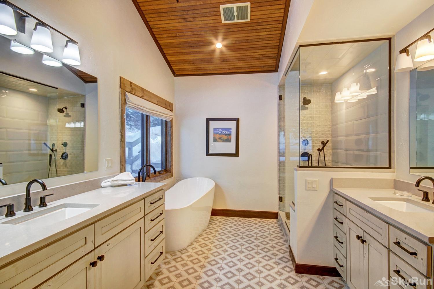 Creekside Chateau Mid-level master ensuite bath with soaking tub, walk-in tile shower