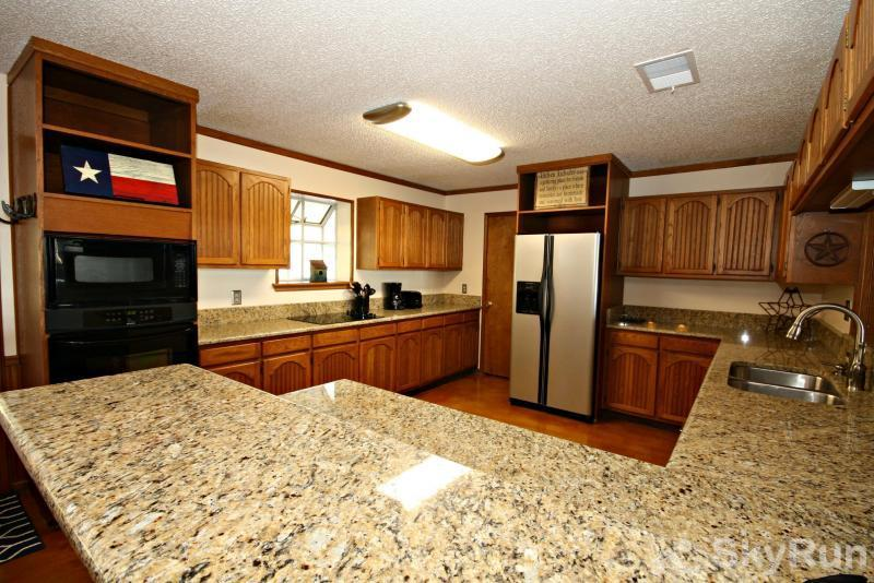 TEXAS LAKE HAUS Fully Equipped Kitchen with Granite Counters