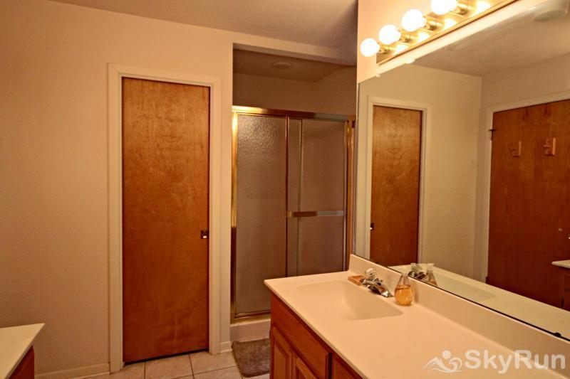 GUADALUPE RIVER GETAWAY Master Bath with Dual Sinks and Shower